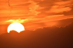 Warm sun in orange sky