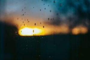 Golden sky, dark clouds, and rain