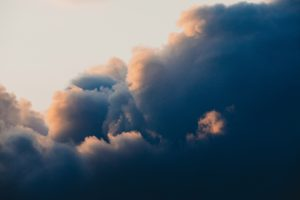 Voluminous clouds illuminated by sun
